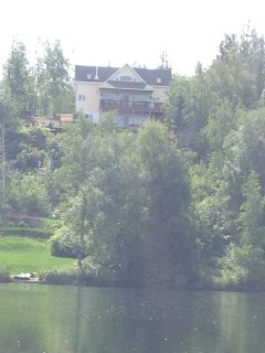 the chalet is located on a ridge above the lake.
