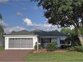 Enjoy The Villages, FL in this charming pet friendly villa with a golf cart!