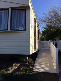 Tribal spirits cosy static caravan with sea views, Borth