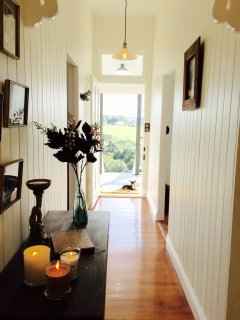 Hallway looking out to the front veranda and amazing views of lush farmland & beautiful sunsets