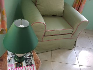 One seater sofa with side light for easy reading..