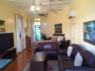 Living area.  Plasma TV,DVD,Apple TV. FREE WiFi. Double or single sofa-beds.