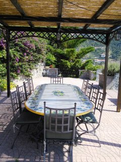 Under the gazebo with a closer look at the ceramic table for al fresco dining