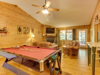 Quaint, dog-friendly cabin w/ screened-in deck, private hot tub, & firepit