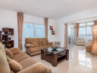 Light and airy lounge with superb views of the Marina