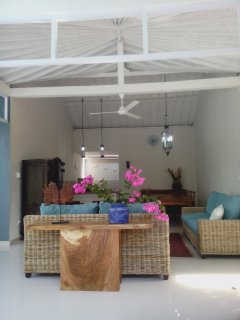 The lounge/dining/kitchen area can be screened off with beautiful aqua voiles and clear awnings