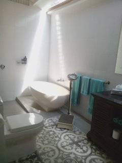 The beautiful stone bath and Sidemen floor tiles make for a beautiful bathroom