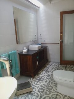 The large ensuite has wheelchair showering and extra wide doors were made