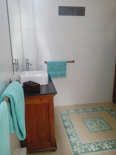 The smaller bathroom is fully fitted but without a bath