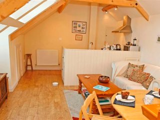 The reverse accommodation has a light and airy living space upstairs with a kitchen area