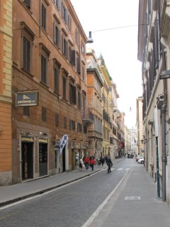 Our street: wide sidewalks, one lane/one way traffic, no parking in front of our palazzo ...