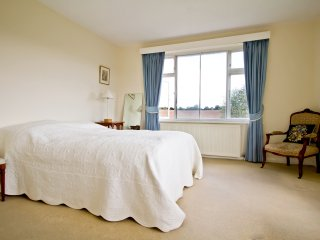 Master bedroom with king sized bed  and delightful countryside views