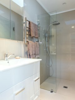 Sparkling bathroom with rain shower and heated towel rails