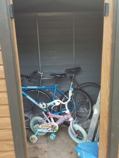 The bike shed which has 1adult bike and 1 child's bike up to 5 yrs old approx.