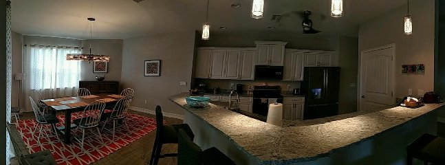 Kitchen and dining open floor plan with high end finishes.