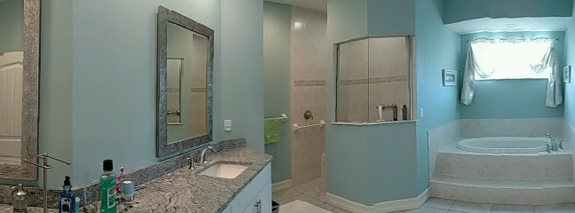 Huge and lovely master bath, granite counters.