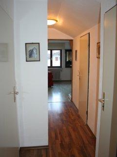 Hallway with hidden coatrail and boot rack