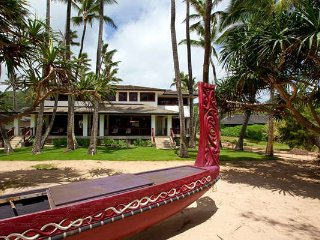Hale Koa View from beach toward home, with handcarved canoe on the foreground.Beachfront home!