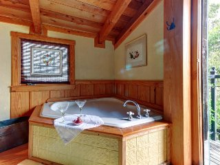 Relax in a whirlpool tub with this old-fashioned cabin featuring modern comfort!