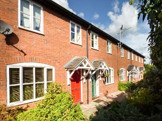 4 ALDELYME COURT, mid-terrace, private enclosed garden, electric gated courtyard