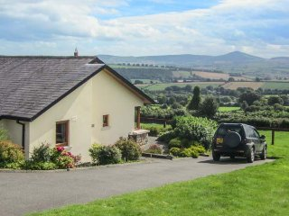 MINMORE FARM COTTAGE, pet friendly, country holiday cottage, with a garden in Sh