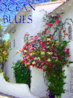 Snapshot view of Ocean Blues front entrance draped in dazzling bougainvillea