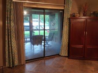 Master bedroom sliding door looking over lake