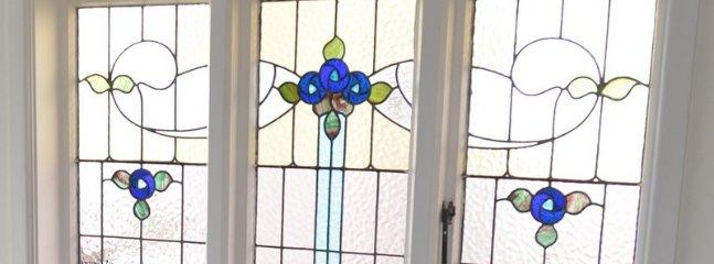 Leadlight window in dining area.