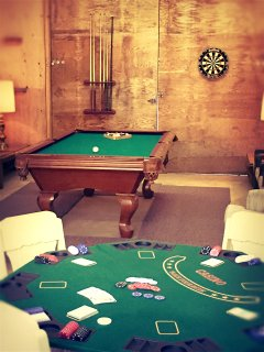 Our new Game Room has a pool table, darts and casino table.