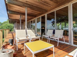 Iconic mid-century home with decks, a private pool & ocean views!