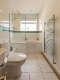 The modern bathroom with shower and luxury Welsh toiletries.