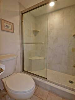 Tiled shower with seat.