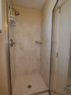 Upstairs tiled shower.
