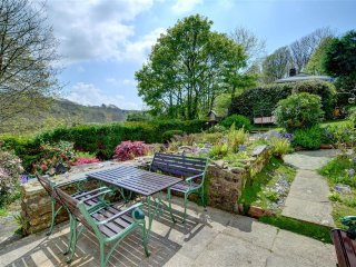 Beautiful private garden with a patio outside the door and views over the wooded valley