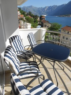 Outside seating on the front balcony with views across the Bay towards Kotor.