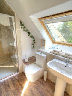 En-suite shower room with walk in shower, off the back twin bedroom. Overlooks the rear garden.