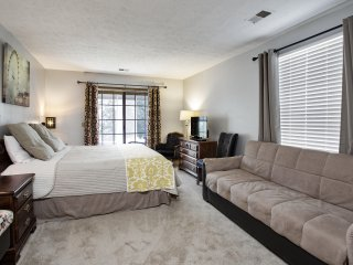 Comfortable king bed and futon sofa sleeper, TV and DVD player, door to patio.