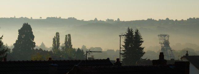 Uitzicht vanaf de Etoilee Suite, ochtendmist