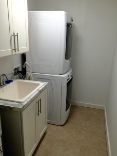Laundry area with front loader machines.