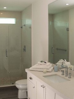 Lovely bathroom with large walk-in shower serves the two first floor bedrooms.
