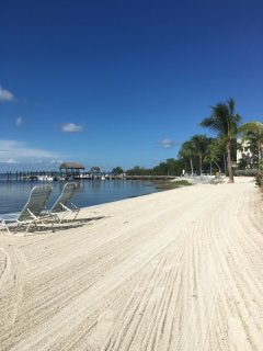 white sand beach, dock and fishing pier outside our door...