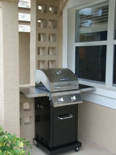 private gas grill on front porch