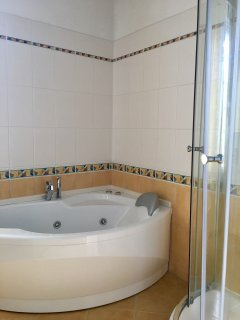 Ensuite to bedroom 2 with shower and spa bath