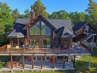 Exquisite 5 Bedroom Log Home offers luxury living in prestigious community!