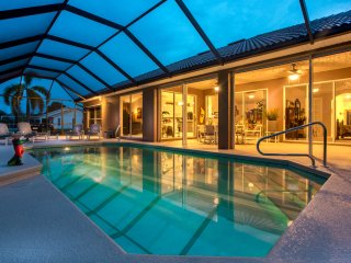Beautiful waterfront home with heated pool and spacious lanai area.
