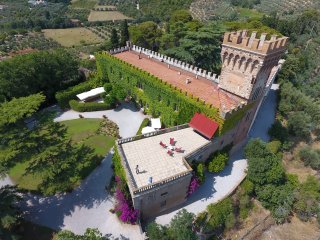 Unique ancient castle near the lovely Tuscan coast. Up to 20 persons, pool & A/C