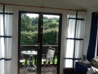 Holiday Wooden Pine Lodge in Saundersfoot - front location with decking & views