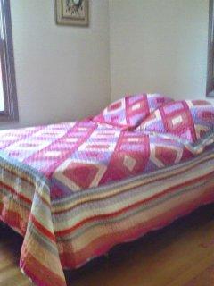 Corner bedroom. Double bed.