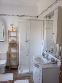 Bathroom with shower screen and washing machine