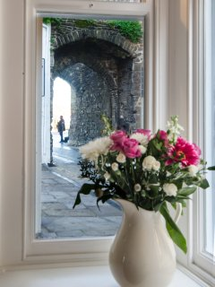 View from the living room bay window through the Porth Isa archway to the quayside